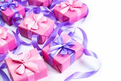 A set of gifts for a newborn pink color on a white background A top view of Flat lay Copy space horizontal Selective focus. A set of gifts for a newborn pink stock images
