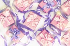 A set of gifts for a newborn pink color on a white background A top view of Flat lay Copy space horizontal Selective focus. A set of gifts for a newborn pink stock image