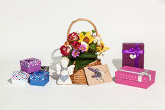 Set of gifts. Sweet set of flowers in basket, different boxes, card and handmade angel on white background Royalty Free Stock Photo