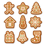Set of Gingerbread Christmas cookies decorated icing. Holiday cookie in shape of Christmas Xmas tree, star, bell, sock, gingerbread men, snowflake, snowman and Royalty Free Stock Image