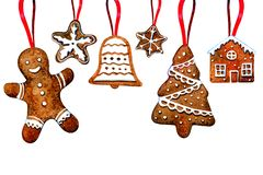 Set of gingerbread cookie figures hanging on red ribbons. Man, christmas tree, bell, stars, house vector illustration