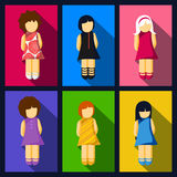 Set of girl flat icons with colorful dresses Stock Image
