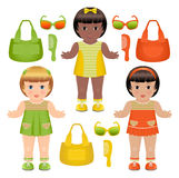 Set of girls dolls with different accessories. Set of three girls dolls with different bags, hairbrushes and sunglasses Stock Photo