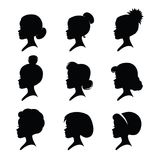 A set of girls silhouettes with classic vintage haircuts. Nine girl heads. Different hairstyles. Black silhouettes isolated on a white background. Vector Royalty Free Stock Image