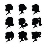 A set of girls silhouettes with long hairs and ponytails. Nine girl heads. Different hairstyles. Black silhouettes isolated on a white background. Vector Stock Photos