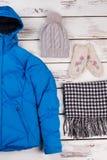 Set of girls` warm clothes Stock Photos