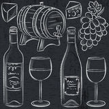 Set of glases and bottles for wine on blackboard Stock Photography