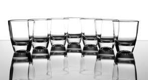 Set glass. Set of the liquor-glasses on glass surface Stock Photos