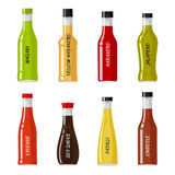 Set of Glass Bottles Full of Hot Sauces Vectors. Set of glass bottles full of hot sauces. Colorful spicy seasonings in shaped bottles flat vector illustrations Royalty Free Stock Photo