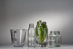 A set of glass bottles on the white table Stock Photos