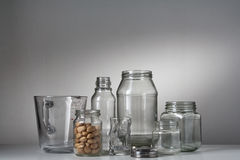 A set of glass bottles on the white table Royalty Free Stock Images