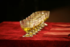 Set of glass bowls of red liquid on the table. The set of glass bowls of red liquid on the table Royalty Free Stock Images