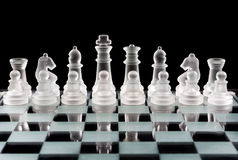 Set of glass chess pieces Stock Image
