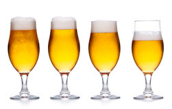 Set of glass of cold light beer with foam on white Royalty Free Stock Images