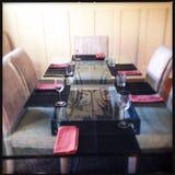 Set glass dinner table Stock Photo
