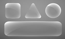 Set of glass figures of various shapes on a gray b Royalty Free Stock Photos