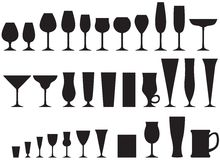 Set of glass goblets. Set of silhouette images of glass glasses for different drinks Stock Images