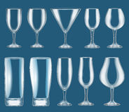 Set of glass wine glasses on a dark background Royalty Free Stock Image