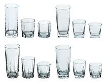 Set of glasses for drinks on white Stock Photos