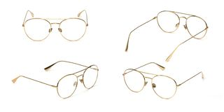 Set glasses gold metal material business style transparent isolated on white background. Collection fashion office eye glasses.  stock photos
