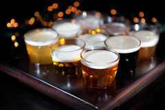 Set of glasses of light and dark beer on a pub background. Stock Photo