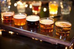Set of glasses of light and dark beer on a pub background. Stock Images