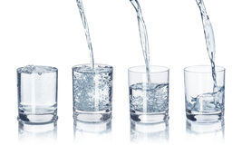 A set of glasses with water on an Stock Photo