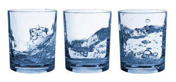 Set of glasses water splash Stock Photography