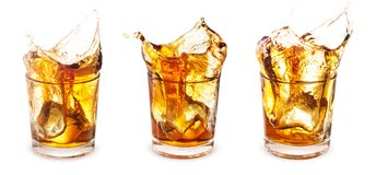 Set of Glasses of whiskey with a splash Stock Photo