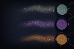 Set of glitter eyeshadow make up and powder sparkle dust Royalty Free Stock Images