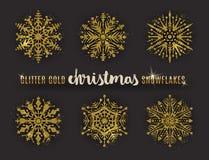Set of glitter gold ornate snowflakes. Stock Photos