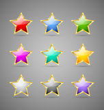 Colorful stars. Set of glossy golden colorful stars  on grey background Stock Images