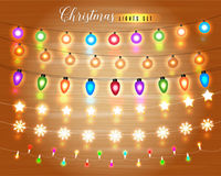 Set of Glowing Christmas Lights for Xmas Holiday Greeting Cards Design. Wooden Hand Drawn Background. Light Bulbs Collection. Stock Image