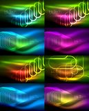 Set of glowing ellipses dark background, waves and swirl, neon light effect, shiny vector magic effects. Set of glowing ellipses dark background, waves and swirl Stock Photo