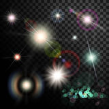 Set of glowing light effect. Star flash and spangles on transpar Royalty Free Stock Images