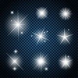 Set of Glowing Light Stars with Sparkles Vector Stock Photography