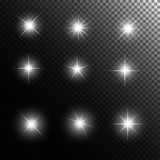 Set of Glowing Light Stars with Sparkles Vector Stock Photos