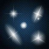Set of Glowing Light Stars with Sparkles Vector Royalty Free Stock Photos