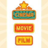 Set of glowing retro cinema neon signs Royalty Free Stock Photo