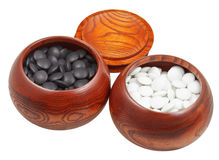 Set of go game stones in wooden bowls Stock Photos