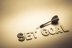 Set goal and dart. Wood letters of Set Goal word with dart Stock Photos
