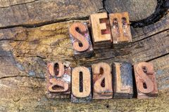 Set goals attitude letterpress. Set goals positive attitude success letterpress text type typography retro rustic old weathered background stock photography