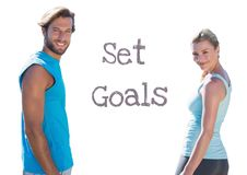 Set Goals text and fitness couple. Digital composite of Set Goals text and fitness couple stock photo