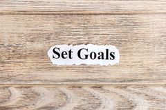 Set goals text on paper. Word Set goals on torn paper. Concept Image Royalty Free Stock Image