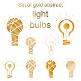 Set of gold abstract light bulb. Stock Photography