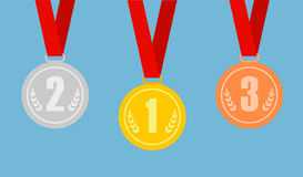 Set of gold, bronze and silver medals on red ribbons. Royalty Free Stock Photography