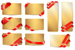 Set of gold business cards with red ribbons. Stock Photos