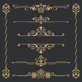 Set of gold calligraphical. Flower elements of design. Execution of the page. Allocation of the text in vintage style. Typographical dividers, jewelry for Stock Photo