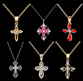 Set gold cross pendant with gems Royalty Free Stock Photo