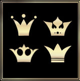 Set gold crowns on black background Royalty Free Stock Photos